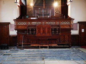 Image of the church pulpit after it was reduced in depth and reinstalled