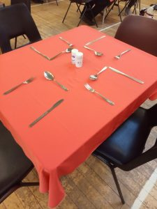 A table set with cutlery and condiments